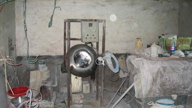 "This September 2005 photo provided by Pfizer shows an illegal pharmaceutical ""factory"" in Henan Province, China, during a raid where authorities seized 10 lines of manufacturing equipment and counterfeit medicines valued at $4.3 million (USD), including about 440,000 counterfeit Viagra.  In a first for the drug industry, Pfizer Inc. told The Associated Press on May 6, 2013, that it will sell erectile dysfunction pill Viagra directly to patients on its website. (AP Photo/Pfizer)"