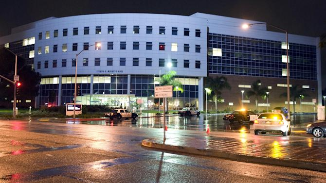 Police vehicles pull up to Mihaylo Hall at the Cal State Fullerton campus, Wednesday, Dec. 12, 2012, in Fullerton, Calif. Students were placed on lock down as police searched for two suspects in a jewelry store robbery, who were considered armed and dangerous. (AP Photo/The Orange County Register, Bruce Chambers)