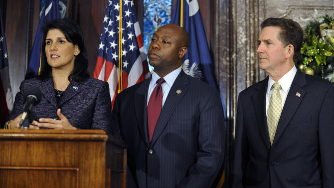 South Carolina Gov. Nikki Haley, left, speaks at a news conference as she announces U.S. Rep Tim Scott, center, as the state's next U.S. senator as Sen. Jim DeMint looks on at the South Carolina Statehouse on Monday, Dec. 17, 2012, in Columbia, S.C. Haley's pick makes Scott the only black Republican in Congress and the South's first black Republican senator since Reconstruction. (AP Photo/Rainier Ehrhardt)