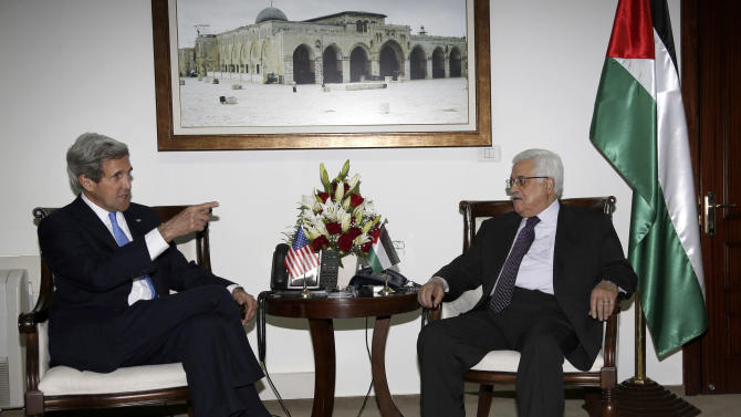 Palestinian President Mahmoud Abbas, right, meets with U.S. Secretary of State John Kerry in the West Bank city of Ramallah Sunday, April 7, 2013. (AP Photo/Mohamed Torokman, Pool)