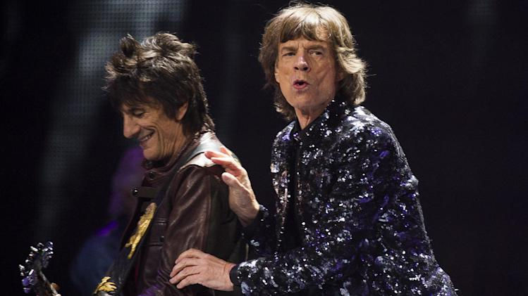 FILE - In this Saturday, Dec. 8, 2012 file photo, Ronnie Woods, left, and Mick Jagger of The Rolling Stones perform in concert in New York. On their show Saturday, Dec. 15 at the Prudential Center in Newark, N.J., The Rolling Stones will be joined by Bruce Springsteen, Lady Gaga and the Black Keys. (Photo by Charles Sykes/Invision/AP, File)