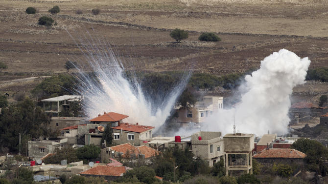 """Smoke rises after shells fired by the Syrian army explode in the Syrian village of Bariqa, Monday, Nov. 12, 2012. The Israeli military says """"Syrian mobile artillery"""" was hit after responding to stray mortar fire from its northern neighbor. The incident marked the second straight day that Israel has responded to fire from Syria that does not appear to be aimed at Israeli targets, nonetheless Israel has promised a tough response if the fire continues. (AP Photo/Ariel Schalit)"""