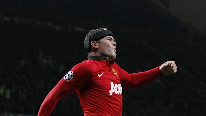 Manchester United's Wayne Rooney celebrates after he scored the third goal of the game for his side during their Champions League Group A soccer match at Old Trafford in Manchester, England, Tuesday Sept 17, 2013