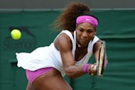 US player Serena Williams plays a double-handed backhand shot during her fourth round women's singles victory over Kazakhstan's Yaroslava Shvedova on day seven of the 2012 Wimbledon Championships tennis tournament at the All England Tennis Club in Wimbledon, southwest London. Serena won 6-1, 2-6, 7-5