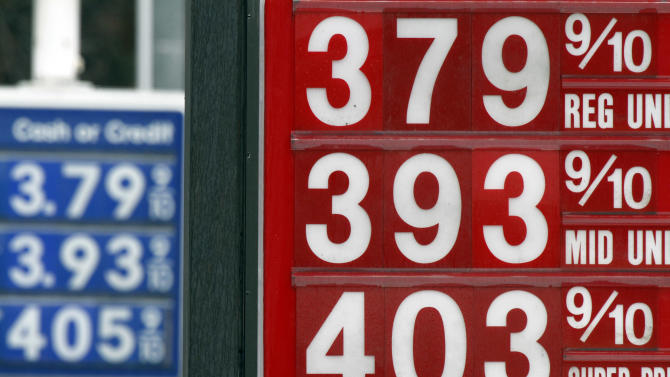 In this Friday, March 16, 2012 photo, a sign displays gas prices in Montpelier, Vt. A statistical analysis of 36 years of monthly inflation-adjusted gasoline prices and U.S. domestic oil production by The Associated Press shows no statistical correlation between how much oil comes out of U.S. wells and the price at the pump. (AP Photo/Toby Talbot)