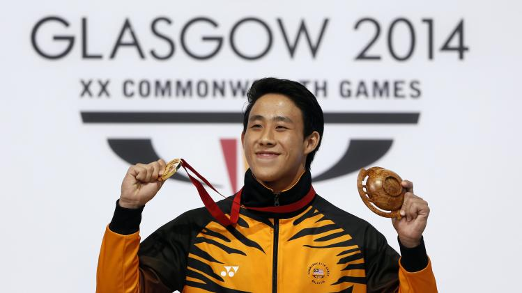 Ooi of Malaysia poses with his gold medal after winning the men's 3m Springboard final at the 2014 Commonwealth Games in Edinburgh