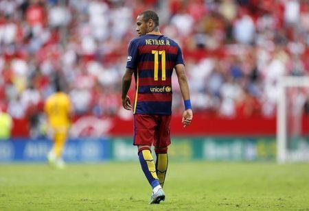 Barcelona's Neymar walks during their soccer match against Sevilla in Seville