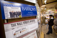 "This Monday, July 23, 2007, file photo shows advertising for on a New York newsstand. Facebook Inc.'s stock took a hit Monday, Sept. 24, 2012, after an article in Barron's said it is ""still too pricey"" despite a sharp decline since its initial public offering. (AP Photo/Mark Lennihan, File)"