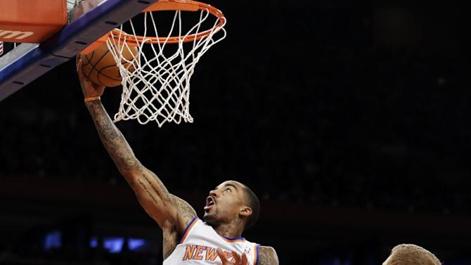 New York Knicks guard J.R. Smith (8) shoots a layup as San Antonio Spurs forward Matt Bonner (15) watches in the second half of their NBA basketball game at Madison Square Garden in New York, Thursday, Jan. 3, 2013. Smith scored 20 points in the Knicks' 100-83 win. (AP Photo/Kathy Willens)