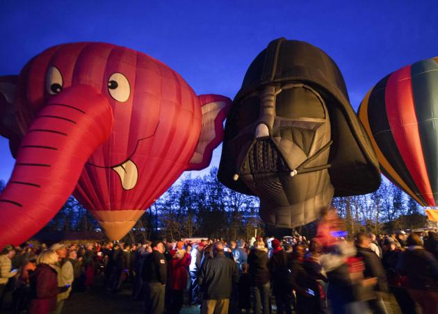Hot air balloons, shaped like the Nelly-B and Darth Vader characters, are displayed during a night glow on the evening of Day 3 of the Canadian Hot Air Balloon Championships in High River