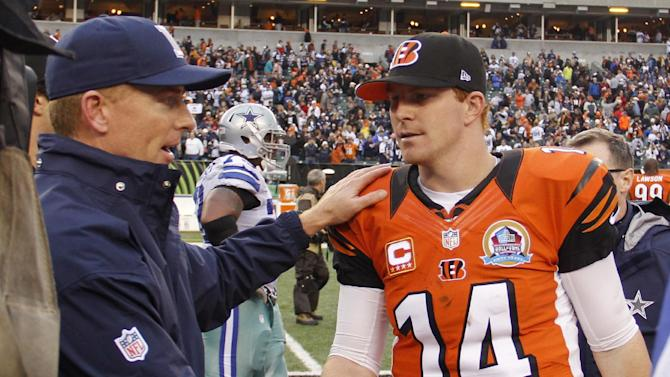 Dallas Cowboys head coach Jason Garrett meets with Cincinnati Bengals quarterback Andy Dalton (14) after the Cowboys defeated the Bengals 20-19 in an NFL football game, Sunday, Dec. 9, 2012, in Cincinnati. (AP Photo/Tom Uhlman)