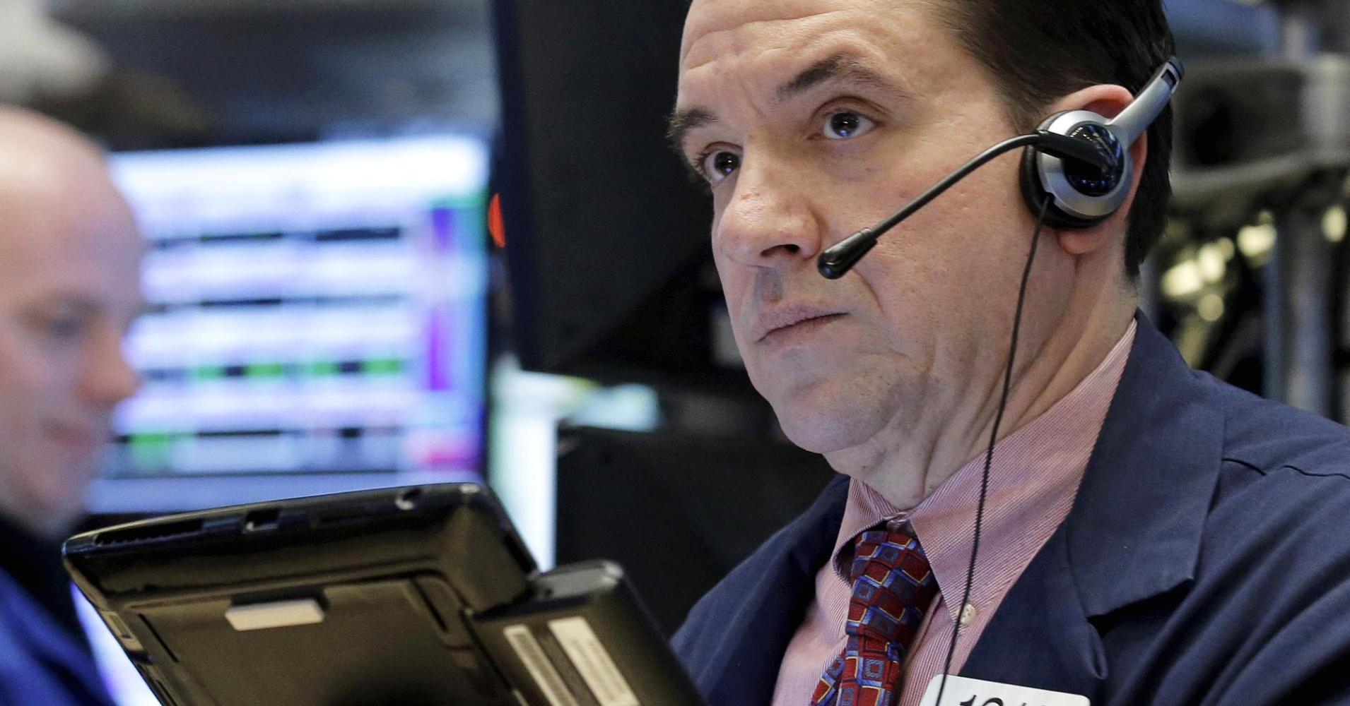 Stocks close higher in choppy trade as oil slides