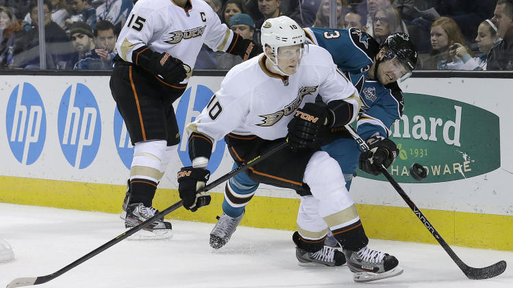 Anaheim Ducks right wing Corey Perry (10) skates toward the puck in front of San Jose Sharks defenseman Douglas Murray (3), from Sweden, during the second period of an NHL hockey game in San Jose, Calif., Tuesday, Jan. 29, 2013. (AP Photo/Jeff Chiu)