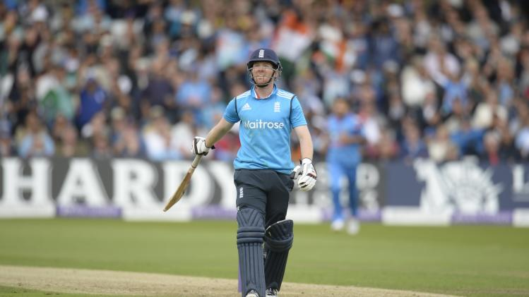England's Morgan leaves the field after being dismissed for 10 runs during the third one-day international cricket match against India at Trent Bridge cricket ground, Nottingham