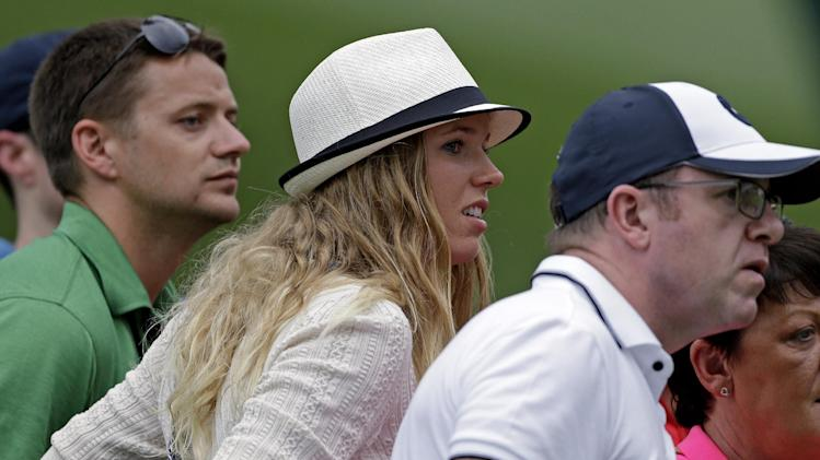 Tennis player Caroline Wozniacki watches Rory McIlroy, of Northern Ireland, during the first round of the Masters golf tournament Thursday, April 11, 2013, in Augusta, Ga. (AP Photo/David Goldman)