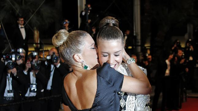 Actress Lea Seydoux, left, kisses actress Adele Exarchopoulos as they arrive for the screening of La Vie D'Adele at the 66th international film festival, in Cannes, southern France, Thursday, May 23, 2013. (AP Photo/Lionel Cironneau)