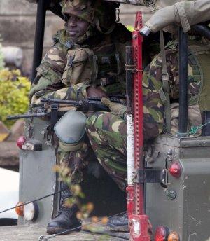 Kenya security personnel arrive in a land rover outside…