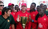 &lt;p&gt;Zimbabwe team players pose with their trophy as they celebrate their victory in the Pran Twenty20 triangular series final played between South Africa and Zimbabwe at the Harare Sports Club. Zimbabwe crushed favourites South Africa by nine wickets as the non-cap Twenty20 tri-nations tournament at Harare Sports Club reached a stunning climax.&lt;/p&gt;