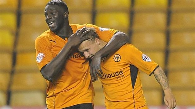 Wolves striker' Leigh Griffiths, right, opened the scoring at Port Vale