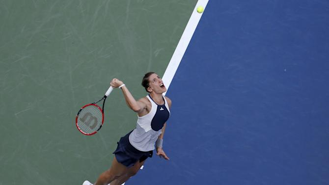 Andrea Petkovic of Germany serves to Caroline Garcia of France in their first round match at the U.S. Open Championships tennis tournament in New York