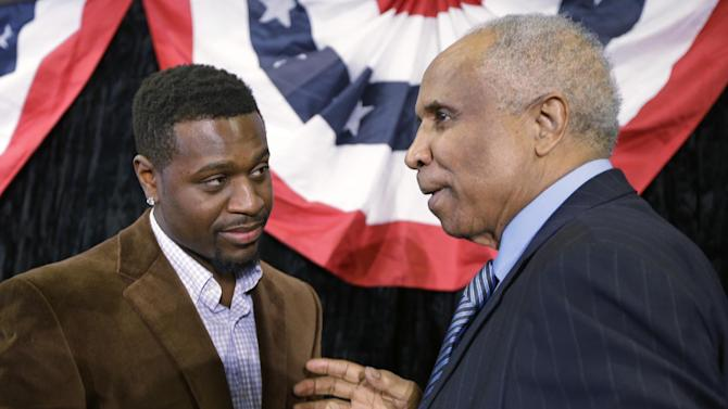 Cincinnati Reds second baseman Brandon Phillips, left, talks with former Reds great Frank Robinson following a news conference, Wednesday, Jan. 23, 2013, in Cincinnati, where it was announced the Reds will host the Major League Baseball All-Star Game in 2015. (AP Photo/Al Behrman)