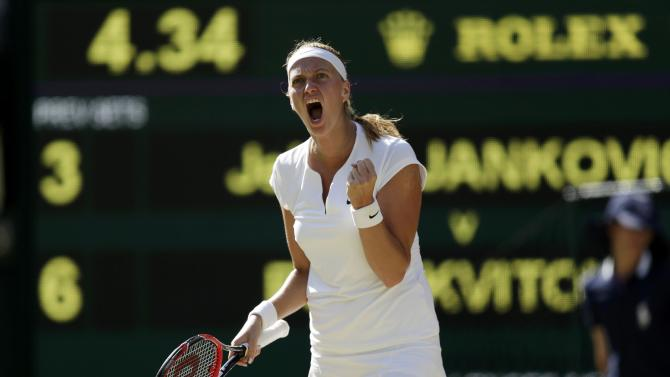 Petra Kvitova of the Czech Republic celebrates breaking serve during her match against Jelena Jankovic of Serbia at the Wimbledon Tennis Championships in London