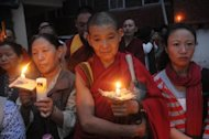Exiled Tibetans hold a candlelight vigil for self-immolation victims near the Indian city of Dharamshala in August 2012. The Dalai Lama has urged Japanese lawmakers to visit Tibet to find out the reasons for a spate of self-immolations