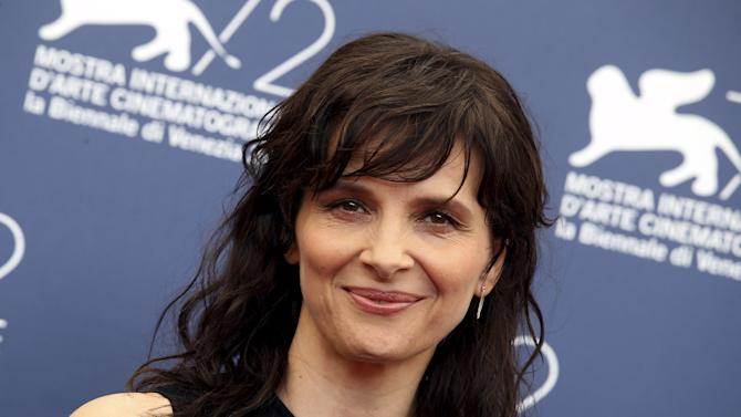 "Actress Juliette Binoche poses during the photocall for the movie ""L'Attesa"" (The Wait) at the 72nd Venice Film Festival"