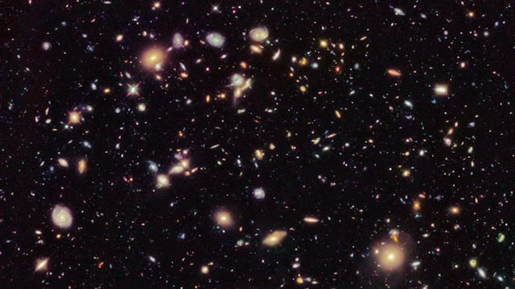 In this image provided by NASA and taken by the Hubble Space Telescope shows previously unseen early galaxies including the oldest one at 13.3 billion years old. Launched in 1990, Hubble has peered deep in time to reveal distant and old galaxies. (AP Photo/NASA)