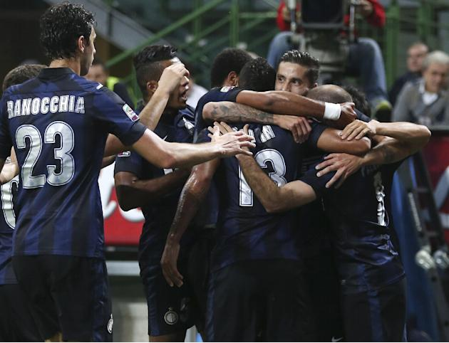 Inter Milan forward Rodrigo Palacio, right, of Argentina, celebrates with his teammates after scoring during the Serie A soccer match between Inter Milan and Hellas Verona at the San Siro stadium in M