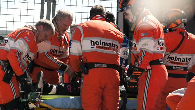 Safety team members load driver Dario Franchitti, of Scotland, into an ambulance after a crash during the second IndyCar Grand Prix of Houston auto race, Sunday, Oct. 6, 2013, in Houston. (AP Photo/Juan DeLeon)
