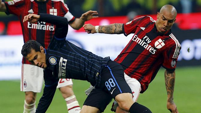 AC Milan's De Jong challenges Inter Milan's Hernanes during their Serie A soccer match at the San Siro stadium in Milan
