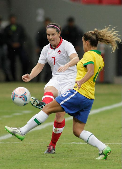 Canada's Rhian Wilkinson (7) kicks the ball past Brazil's Tamires Cassia, during a soccer match at the International Women's Football Tournament in Brasilia, Brazil, Wednesday, Dec. 18, 20