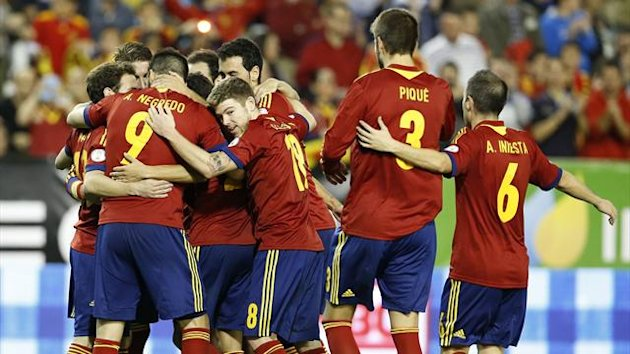 Spain's players celebrate their second goal during their 2014 World Cup qualifying soccer match against Georgia at Carlos Belmonte stadium in Albacete October 15, 2013 (Reuters)