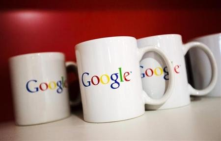 Coffee cups with Google logos are seen at the new Google office in Toronto