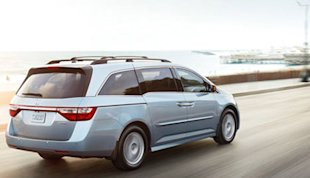 Honda Odyssey: a recommended vehicle with many cupholders and an available rear entertainment system.