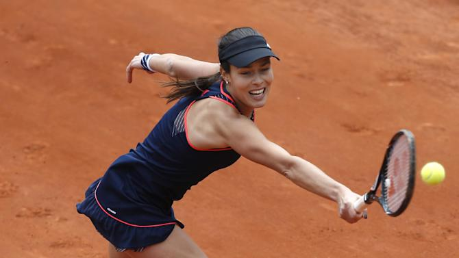 Serbia's Ana Ivanovic returns against Croatia's Petra Martic in their first round match of the French Open tennis tournament, at Roland Garros stadium in Paris, Sunday, May 26, 2013. (AP Photo/Petr David Josek)