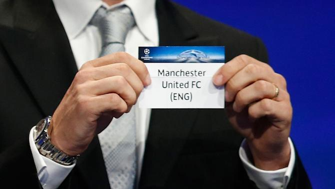Former Italian football player Javier Zanetti shows the name of Manchester United football club during the UEFA Champions League Group stage draw ceremony, on August 27, 2015 in Monaco