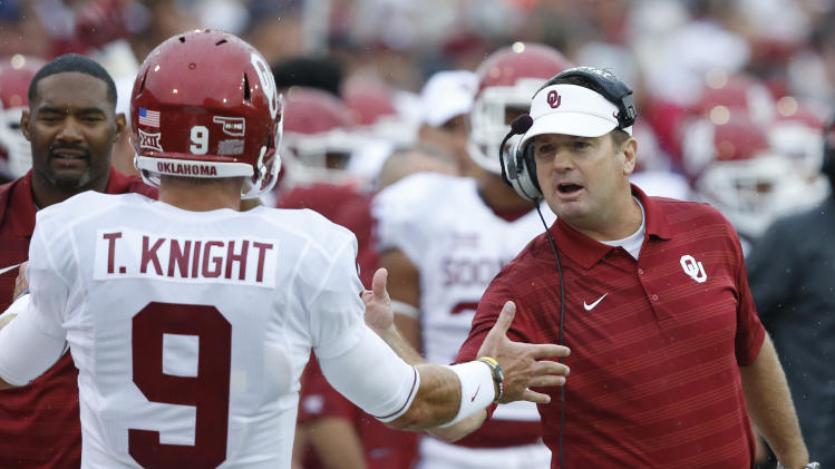 Oklahoma coach Stoops' rivalry with SEC continues