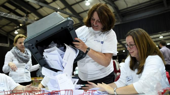 A ballot box is emptied as workers prepare to count ballots at a counting centre in Aberdeen, Scotland