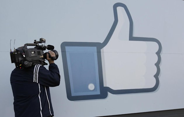 A television photographer shoots the Like sign outside of Facebook headquarters in Menlo Park, Calif., Friday, May 18, 2012. Facebook CEO Mark Zuckerberg symbolically opened trading on the Nasdaq stock market inside Facebook headquarters in Menlo Park. Facebook stock is starting trading today, available to the general public for the first time. The social networking site, which was started in a college dorm room eight years ago, would be valued at more than $100 billion according to the price set for shares ahead of today&#39;s trading. (AP Photo/Paul Sakuma)