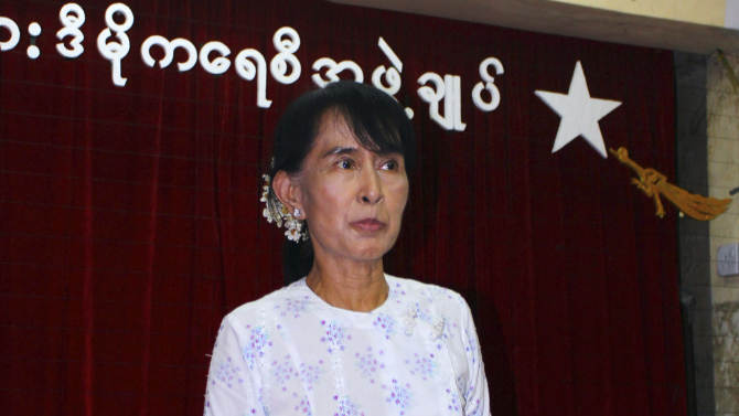 Myanmar pro-democracy leader Aung San Suu Kyi talks to reporters during a press conference at the headquarters of her National League for Democracy party Monday, April 30, 2012, in Yangon, Myanmar.  Suu Kyi said she and other lawmakers in her opposition party will attend Myanmar's parliament on Wednesday for the first time and will take the oath of office though they still fiercely dispute its wording. (AP Photo)