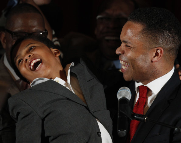 U.S. Rep. Jesse Jackson Jr., D-Ill., and his son Jesse Jackson III, thank supporters at his election night party Tuesday, March 20, 2012, in Chicago after his Democratic primary win over challenger, former Rep. Debbie Halvorson, in the Illinois' 2nd District. (AP Photo/M. Spencer Green)