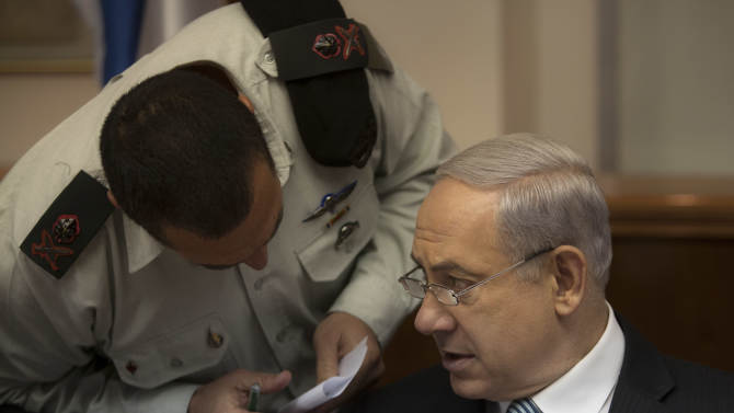 Israeli Prime Minister Benjamin Netanyahu, right, speaks with Military Secretary Eyal Zamir as they attend the weekly cabinet meeting in his Jerusalem office, Sunday, April 28, 2013. (AP Photo/Sebastian Scheiner, Pool)