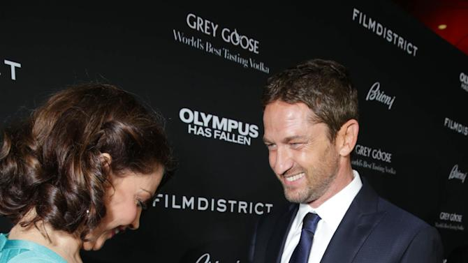 Ashley Judd and Gerard Butler at FilmDistrict's Premiere of 'Olympus Has Fallen' hosted by Brioni and Grey Goose at the ArcLight Hollywood, on Monday, March, 18, 2013 in Los Angeles. (Photo by Eric Charbonneau/Invision for FilmDistrict/AP Images)