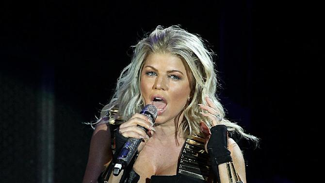 """FILE - In this Friday, Sept. 30, 2011 file photo, singer Fergie of the group Black Eyed Peas performs for the """"Concert 4 NYC"""" at Central Park, Great Lawn in New York.  George Clinton and the Black Eyed Peas have settled a federal lawsuit in which the funk pioneer claimed the pop group used his music without proper permission. The settlement announcement on May 14, 2012, came a few weeks before the two sides were to go to trial, but after a judge limited the amount of damages Clinton would have been eligible to receive. (AP Photo/Donald Traill, File)"""
