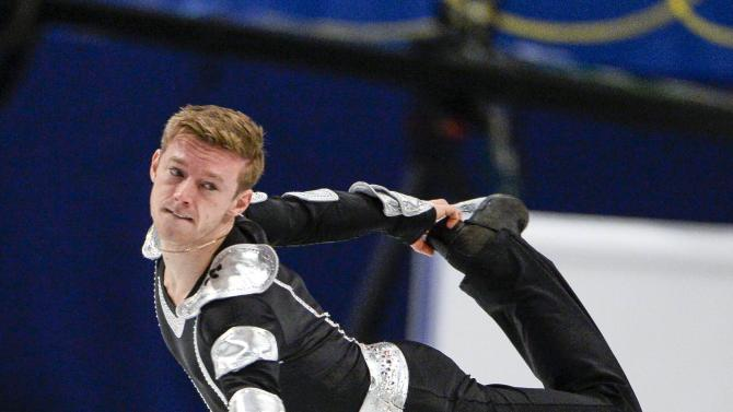 Philip Harris of Great Britain performs during the men's free program at the European Figure Skating Championships in Stockholm