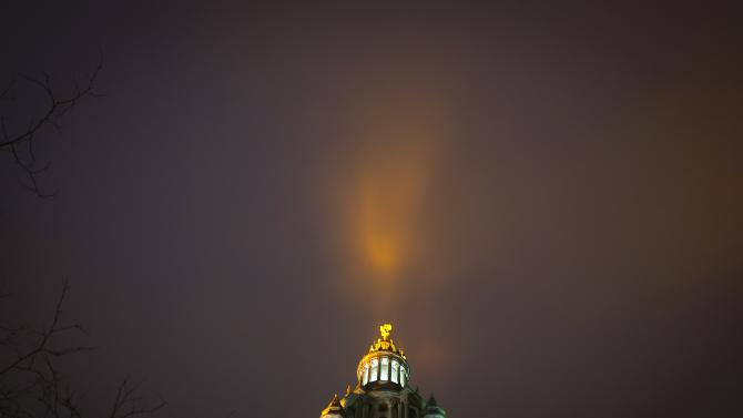 Light pours into fog bank from Manhattan Municipal building in Manhattan borough of New York