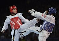 US athlete Paige Mcpherson (blue) fights against Great Britain&#39;s Sarah Stevenson during their women&#39;s taekwondo bout in the category under 67 kg as part of the London 2012 Olympic Games at the ExCel centre in London. Stevenson, who went into the Olympics heartbroken by the death of both her parents, will consider her future in taekwondo after crashing out in the first round