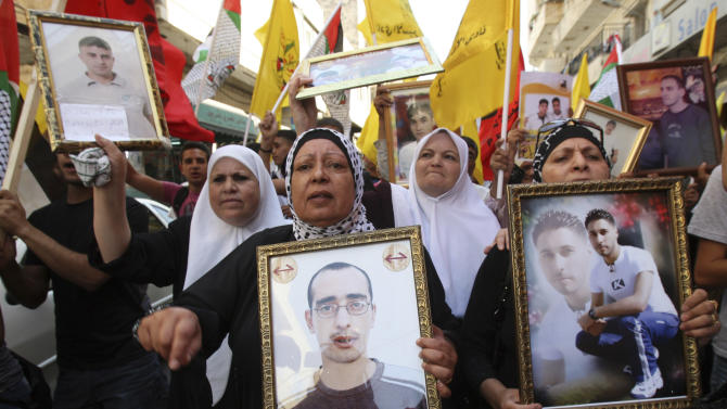 Palestinians participate in a demonstration in solidarity with prisoners jailed in Israel, in the West Bank city of Nablus, Tuesday Oct. 11, 2011. According to the Israeli Prison Service spokesman, over 200 Palestinian prisoners are currently hunger striking, in protest against the worsening of their prison conditions. (AP Photo/Nasser Ishtayeh)